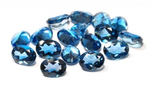 Topaz London Blue fasetowany owal 8/6mm